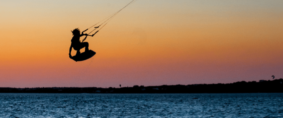 Kitesurfing in Punta Trettu during sunset